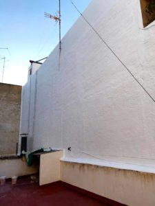 Reparación de patios y medianeras en edificio en Elche